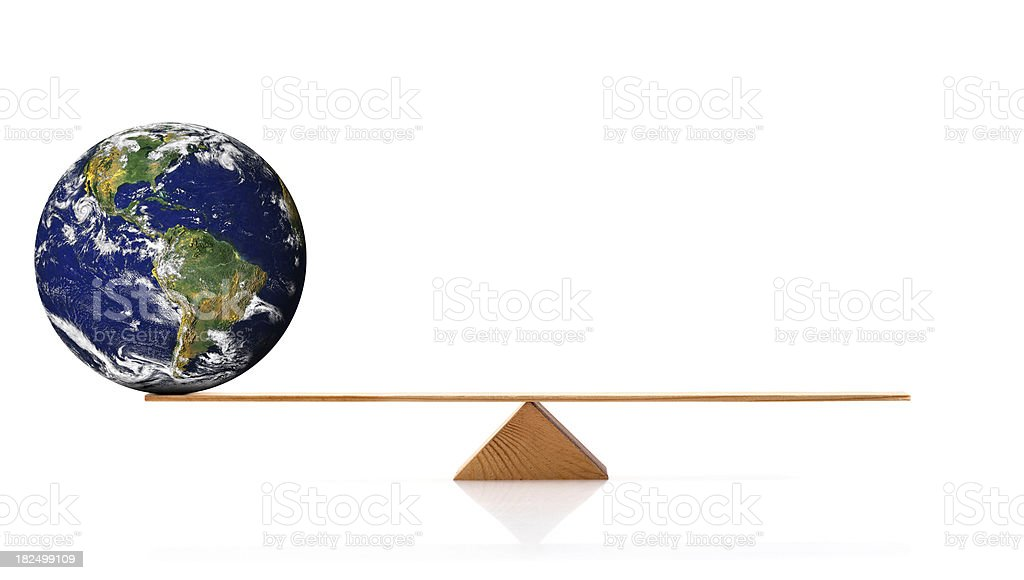 Globe on scale stock photo