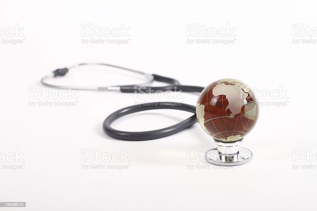 Globe on stethoscope royalty-free stock photo