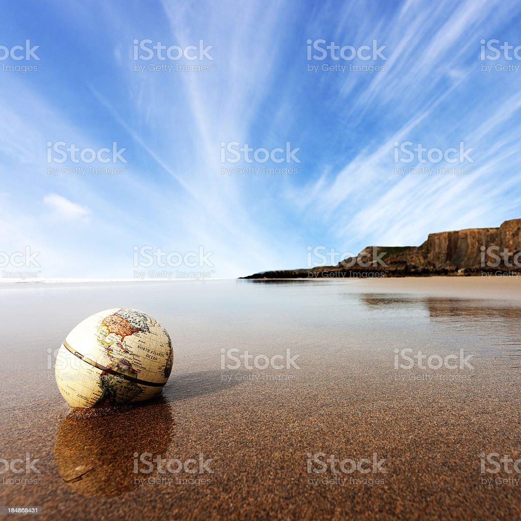 Globe on the beach stock photo
