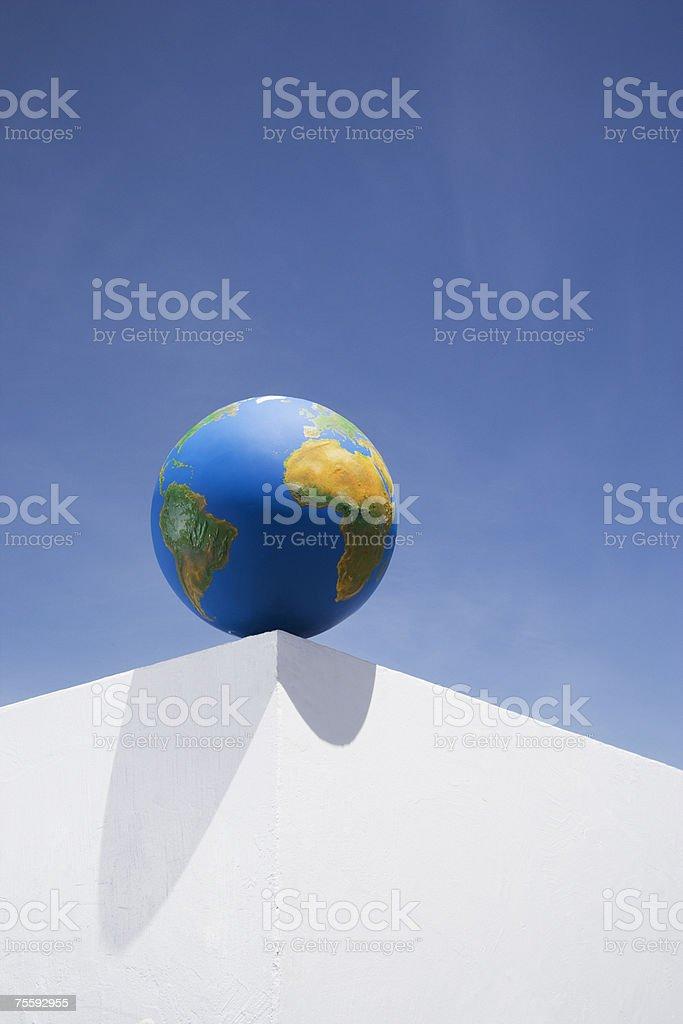 Globe outdoors on corner of wall royalty-free stock photo