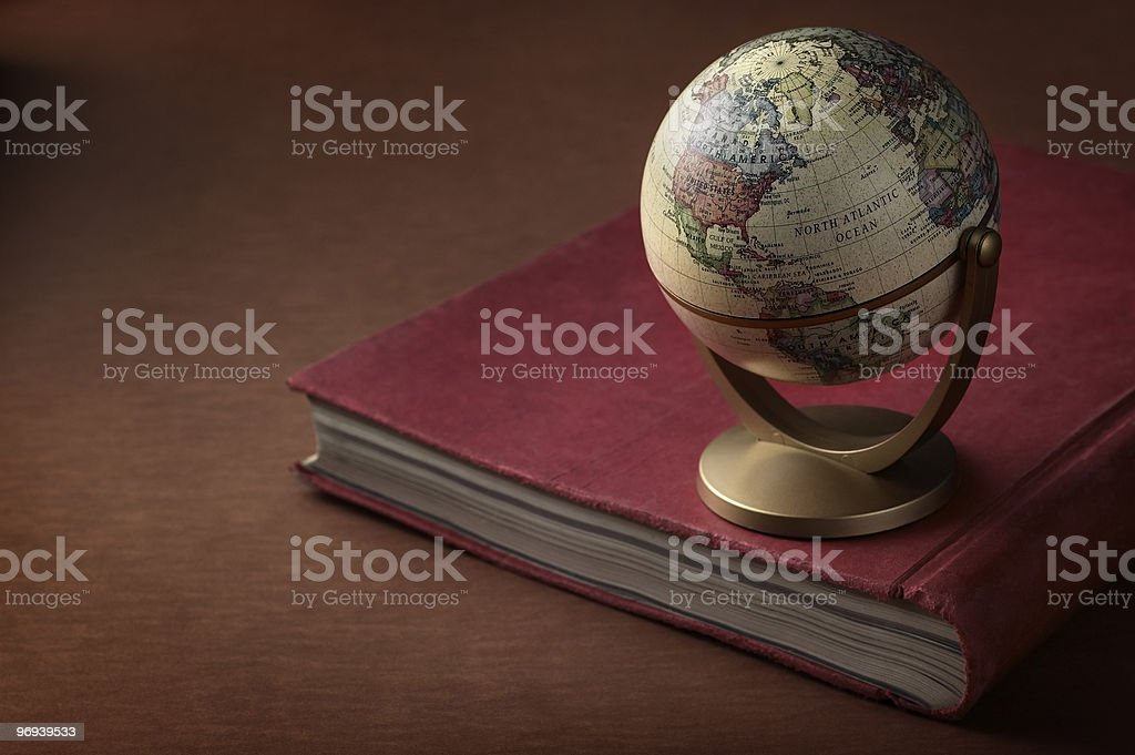 Globe Place On Book royalty-free stock photo