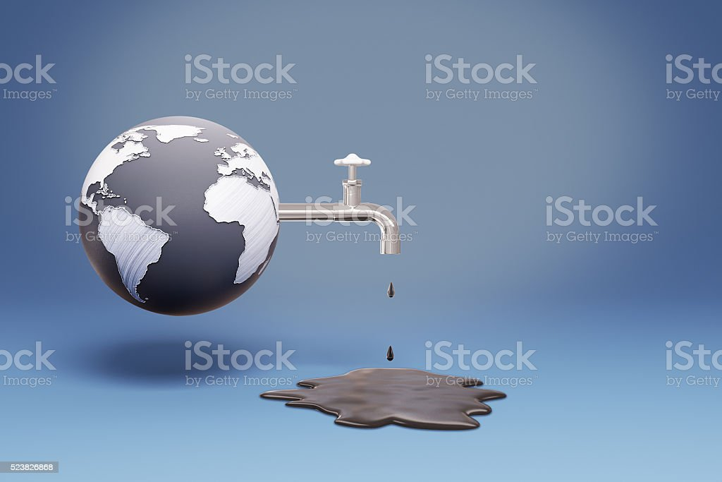 Globe pouring oil stock photo