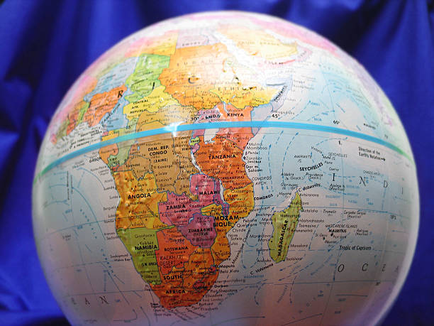 Globe Profile Close up of a globe, Blue material in background. equator stock pictures, royalty-free photos & images