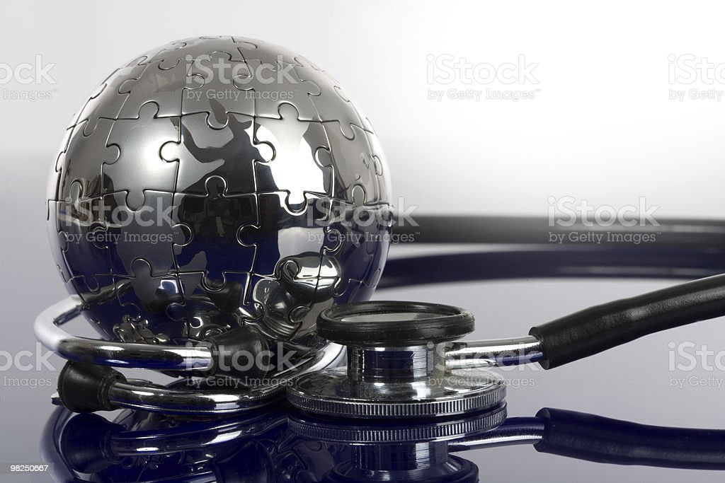 Globe puzzle on blue background. royalty-free stock photo