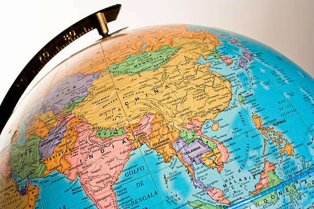 globe showing asia - continent geographic area stock photos and pictures