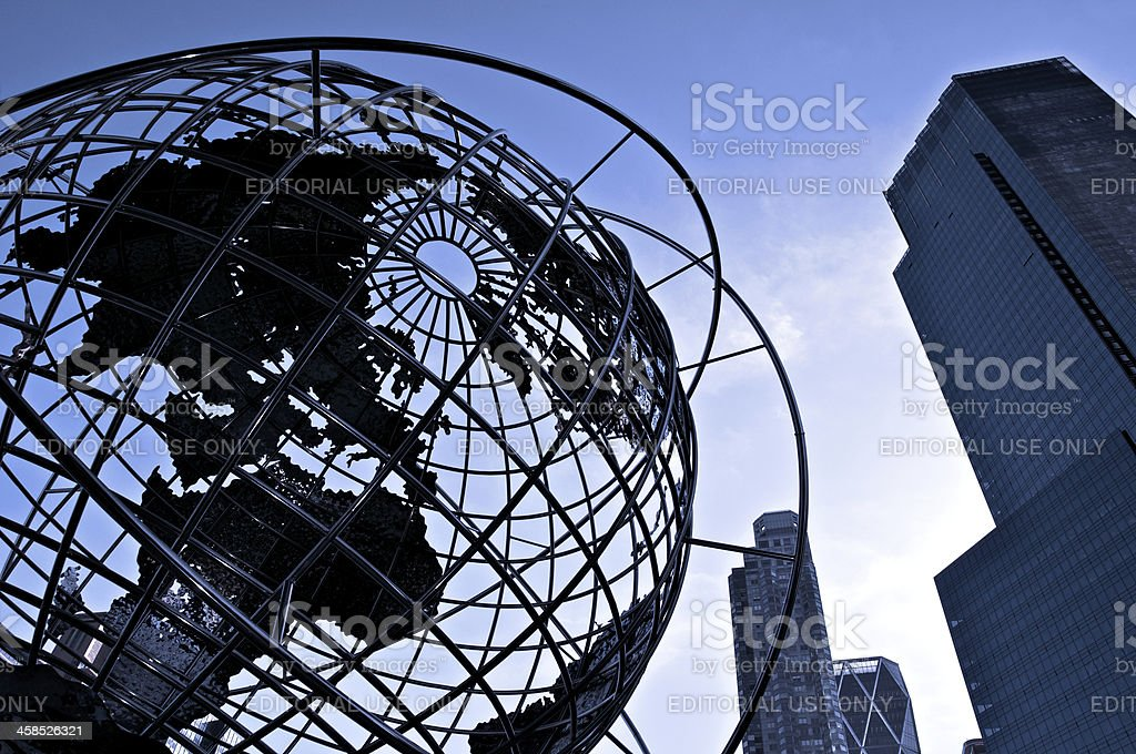 Globe silhouette at Columbus Circle with cityscape, NYC stock photo