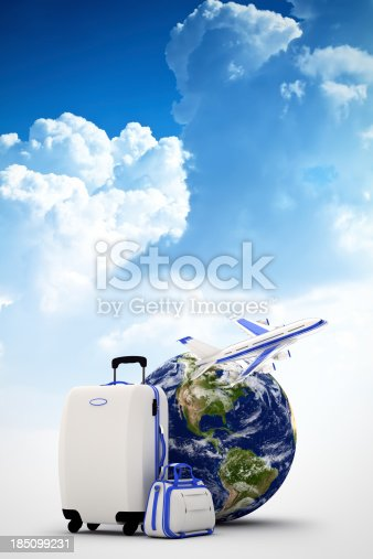istock Globe, suitcases and plane on blue sky background 185099231