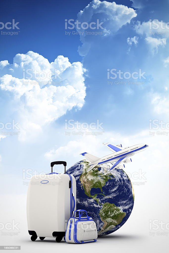 Globe, suitcases and plane on blue sky background stock photo