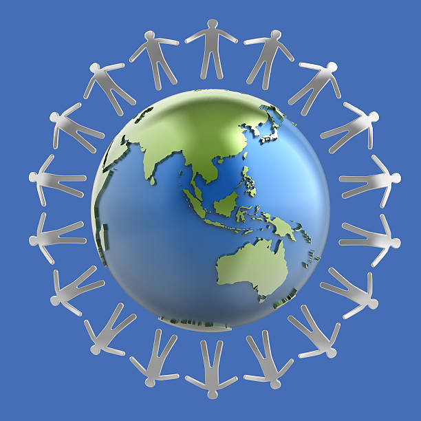 Globe surrounded by metallic human figures - Asia stock photo