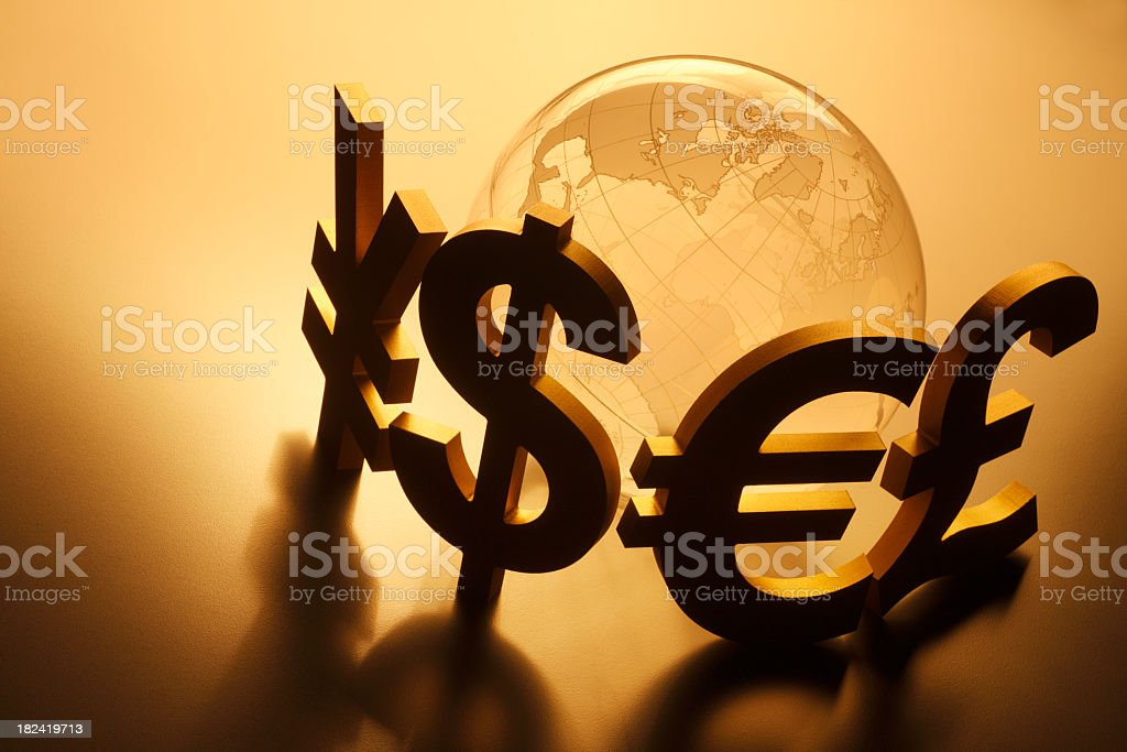 Globe surrounded by several major currency symbols royalty-free stock photo