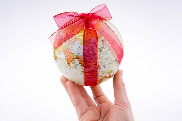 Globe tied with ribbon stock photo