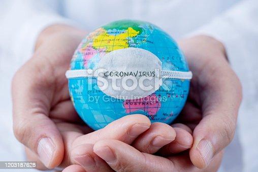istock globe with a mask and text coronavirus 1203187628
