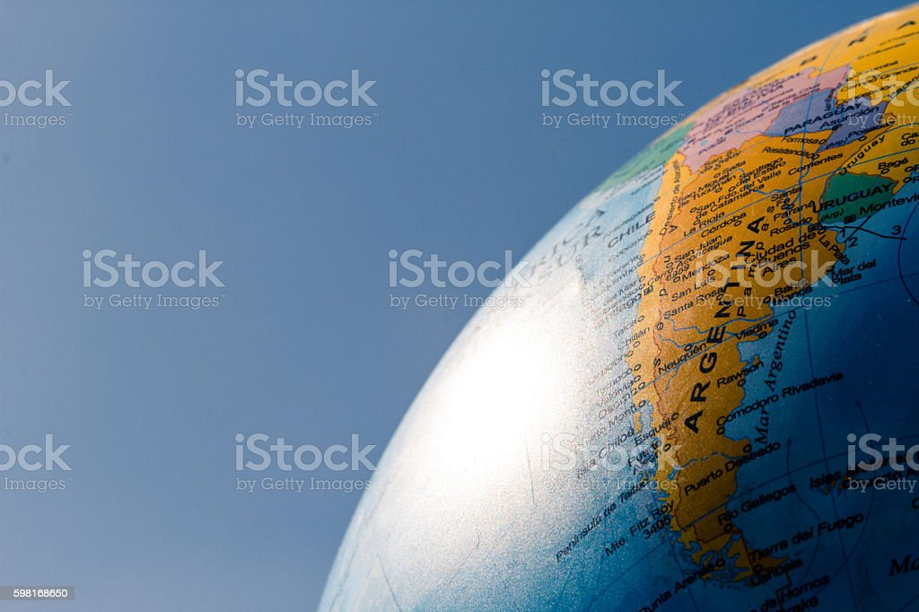 Globe with political division illuminated with sunlight and blue - foto de stock