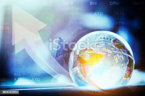 istock Globe with technology  and business icons. Worldwide business concept with growth arrow. 963093850