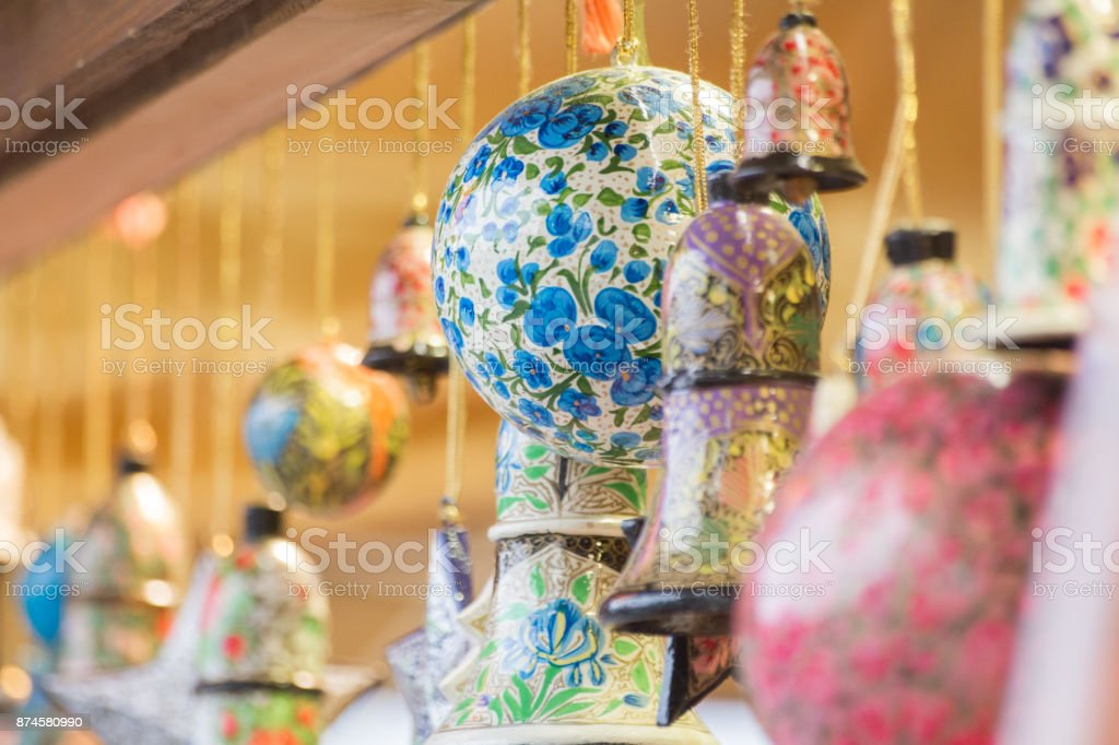 Globes and bells and star ornaments for Christmas made from painted wood royalty-free stock photo