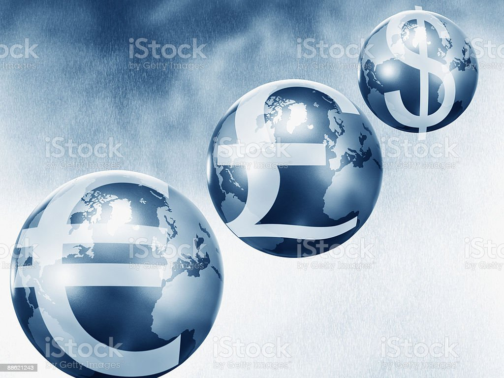 Globes with euro, pound and dollar symbols royalty-free stock photo