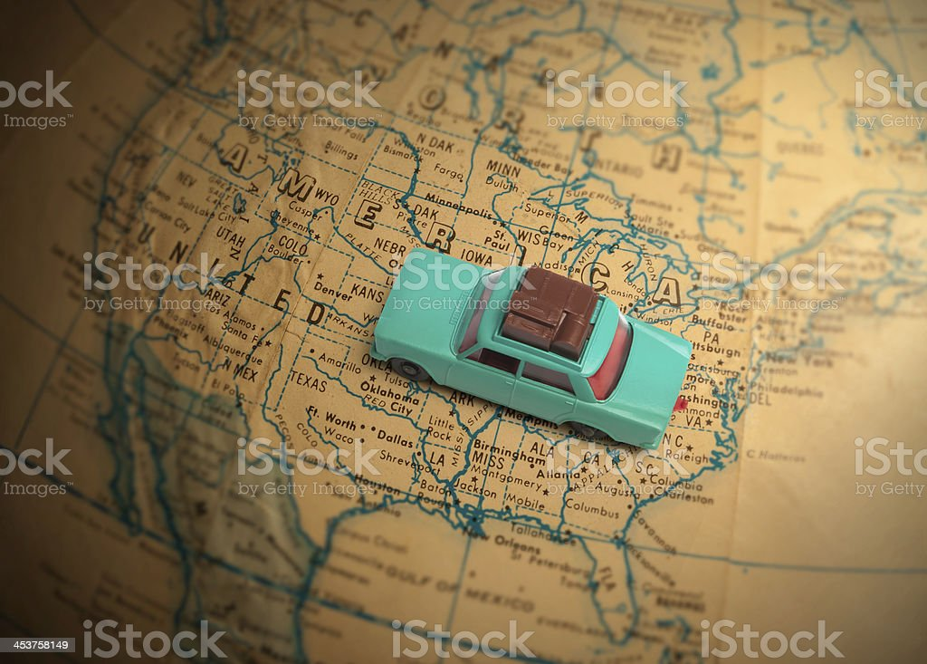 Globetrotting toy car vacation stock photo