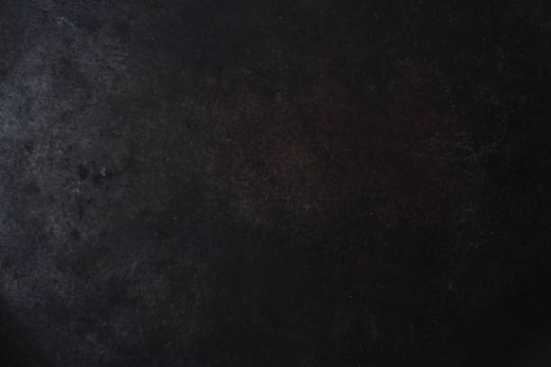 gloomy black painted metal surface. industrial background stock photo