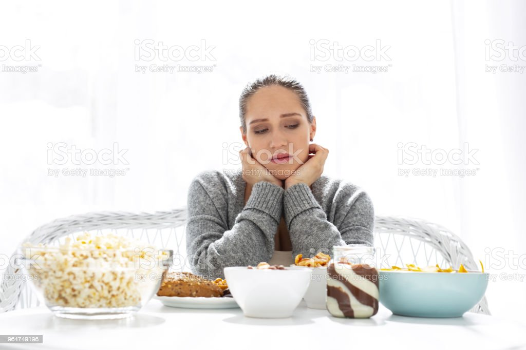 Gloomy bleak woman selecting food royalty-free stock photo
