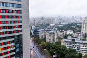 istock Gloomy cityscape skyline of Kiev by Vokzalna rail station metro area during dark rainy cloudy and overcast day 1143674676