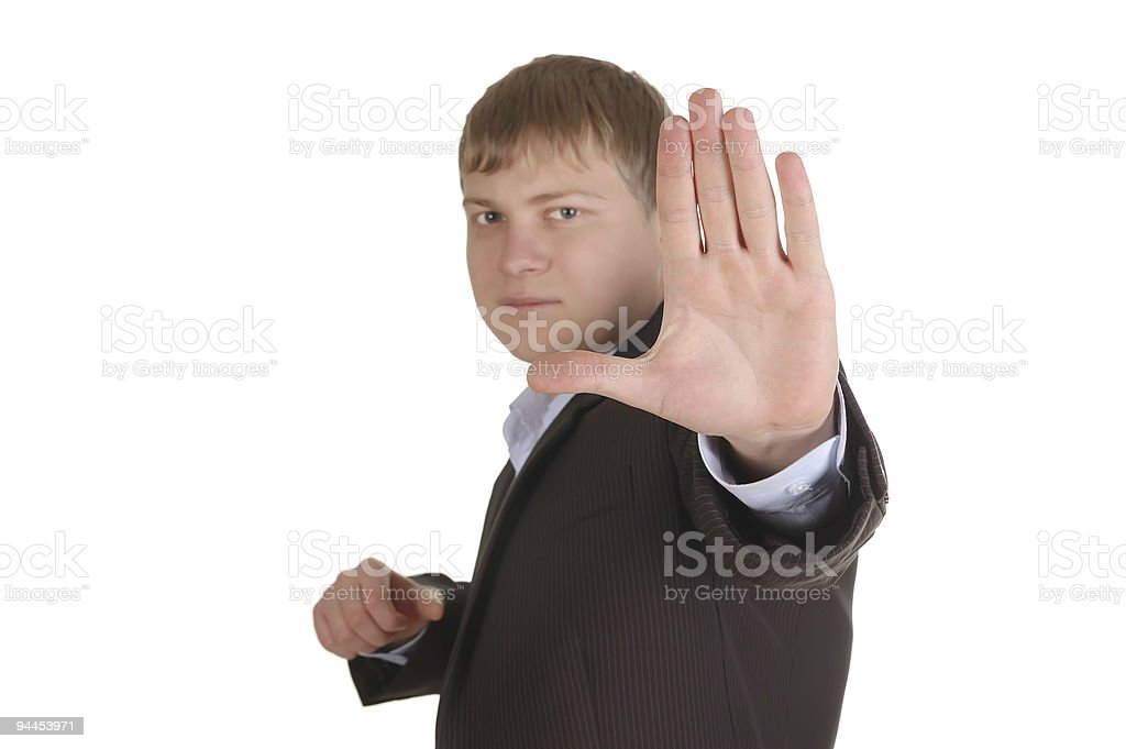 gloomy man in suit making STOP royalty-free stock photo