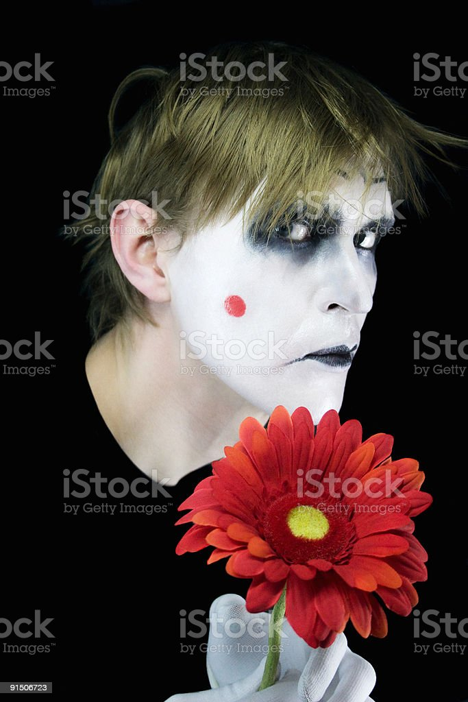 gloomy mime with red flower royalty-free stock photo