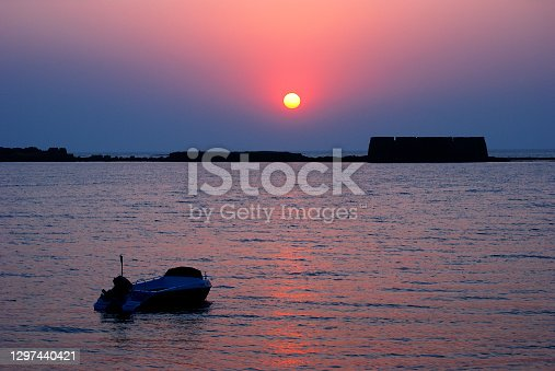 Glorious, colorful sunset behind historical Kolaba Fort, Alibaug, District Raigad, Maharashtra. Kolaba Fort is situated right in the middle of the Arabian sea.