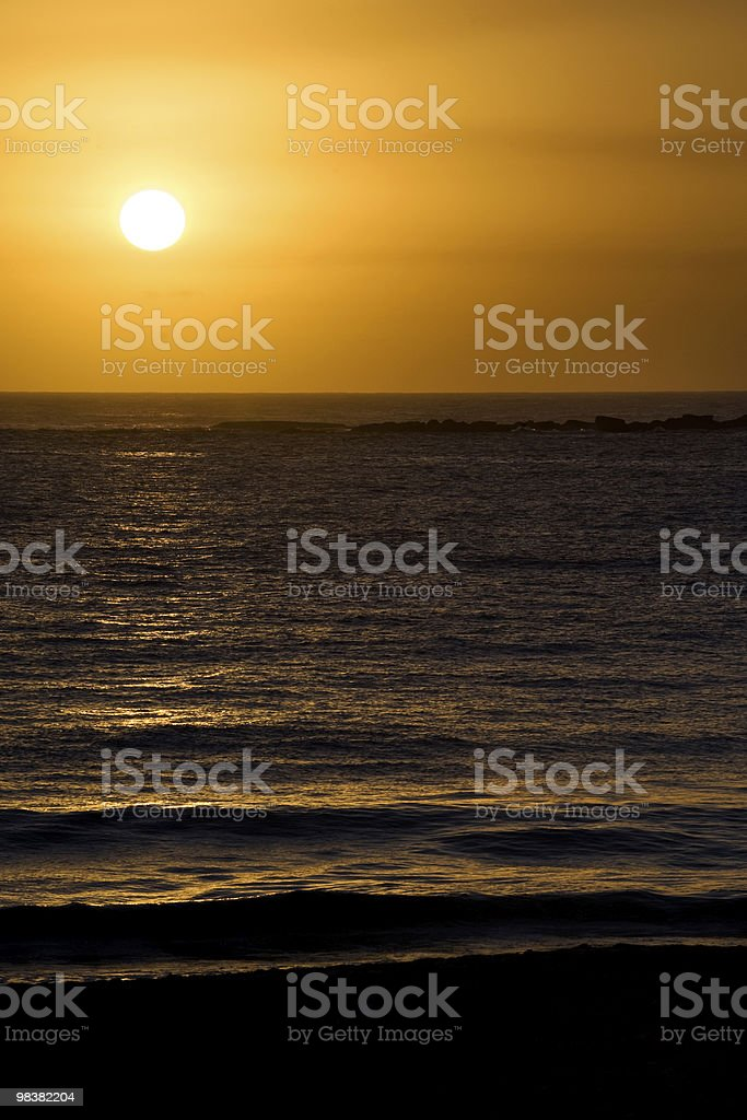 Glorious completed sunrise over ocean and beach.  Clear skies. royalty-free stock photo