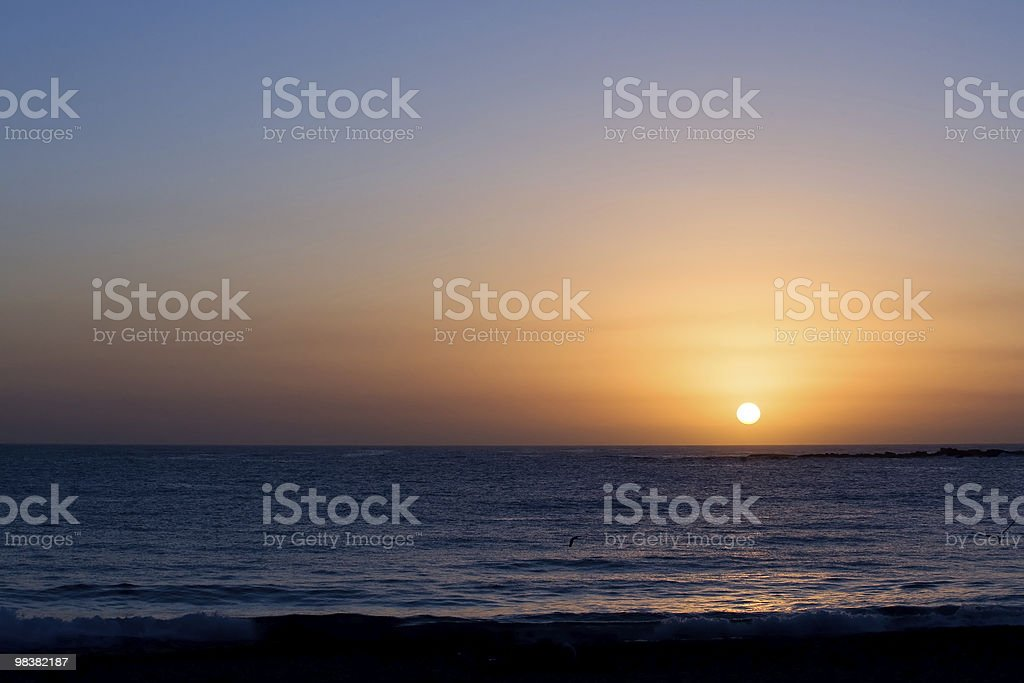 Glorious completed sunrise over ocean royalty-free stock photo