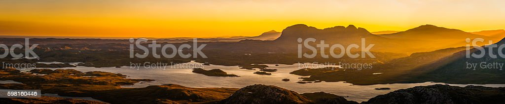 Glorious golden sunrise over Highlands wilderness mountain glen lochs Scotland stock photo
