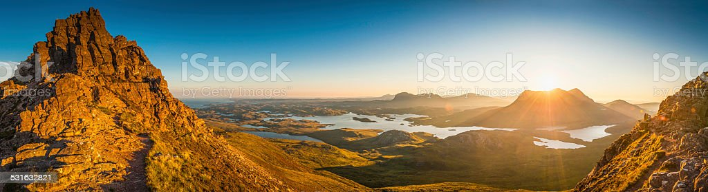 Glorious mountain sunrise golden light on idyllic wilderness Highlands Scotland stock photo