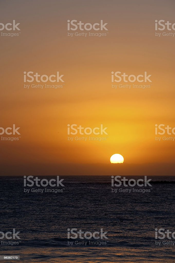 Glorious partial sunrise over ocean, vertical royalty-free stock photo