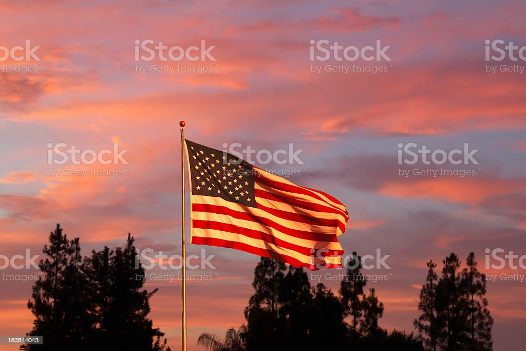 Glorious sunset with American Flag (P) stock photo
