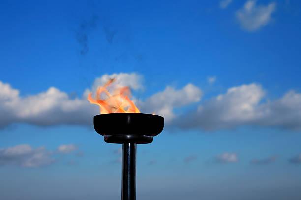 glory burning torch stock photo