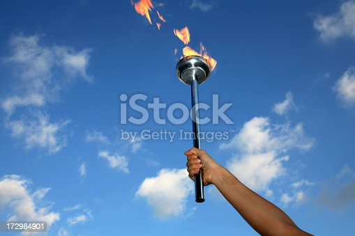 istock glory of holding flaming torch 172964901