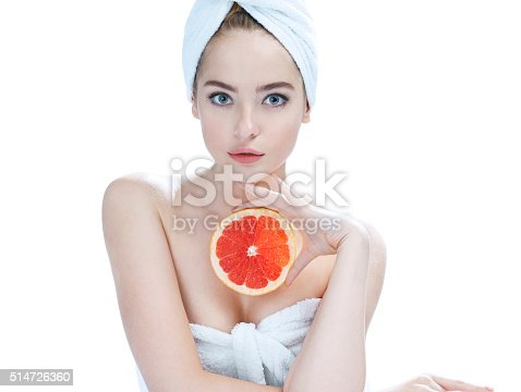 532331272 istock photo Glossy girl with grapefruit cut in half fruit in hand 514726360
