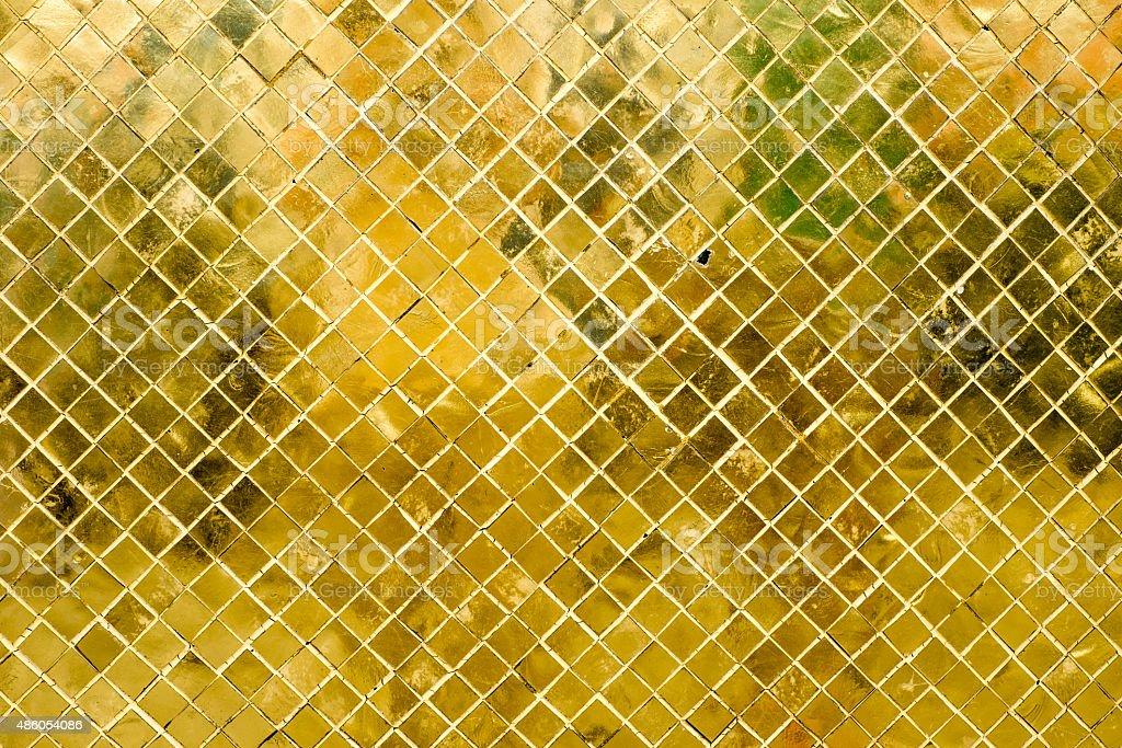 Oro lucida piastrelle a mosaico sfondo di consistenza parete