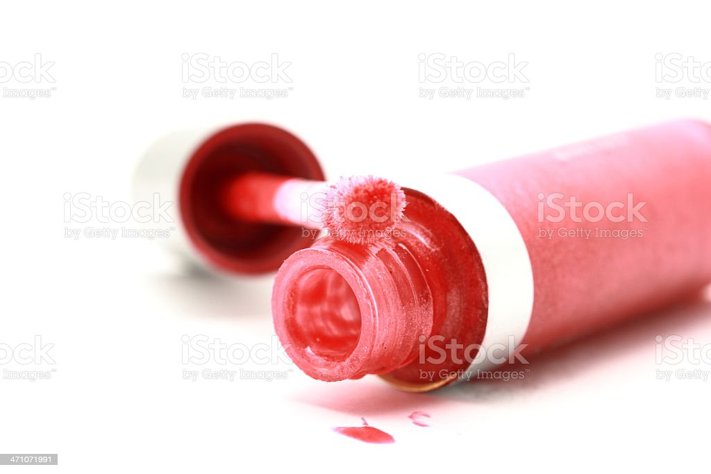 Glossy lipstick on white background royalty-free stock photo