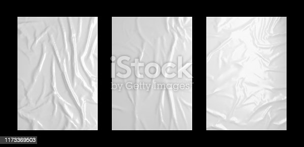 istock Glossy white wrinkled paste poster template set. Isolated glued paper or fabric mockup. 1173369503