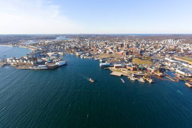 Gloucester City and Harbor, Massachusetts Aerial view of Gloucester City and Gloucester Harbor, Cape Ann, Massachusetts, USA. gloucester massachusetts stock pictures, royalty-free photos & images