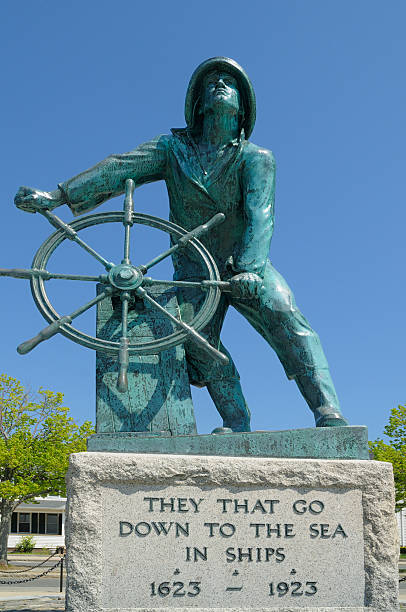 "Gloucester Fisherman's Memorial The Fishermen's Memorial, also known as ""The Man At The Wheel,"" was commissioned as part of the celebration of Gloucester's 300th anniversary in 1923. gloucester massachusetts stock pictures, royalty-free photos & images"
