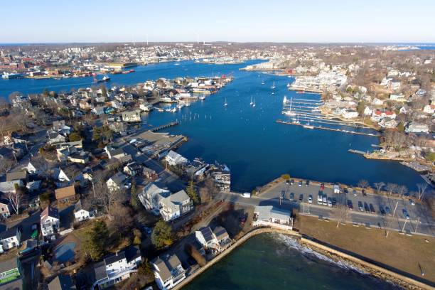 Gloucester Harbor, Massachusetts Aerial view of Rocky Neck and Gloucester Harbor in City of Gloucester, Cape Ann, Massachusetts, USA. gloucester massachusetts stock pictures, royalty-free photos & images