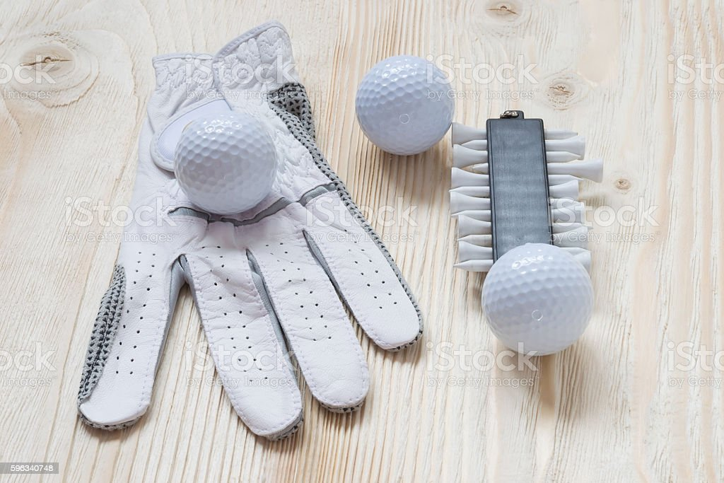 glove and golf balls on a light surface Lizenzfreies stock-foto