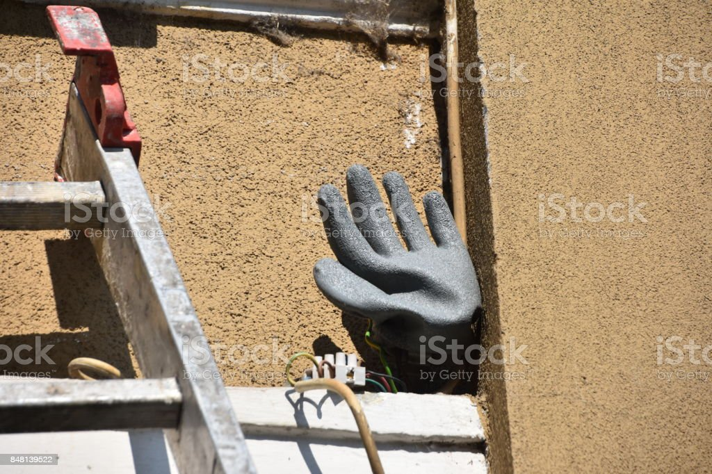 glove covers exposed electrical contacts stock photo