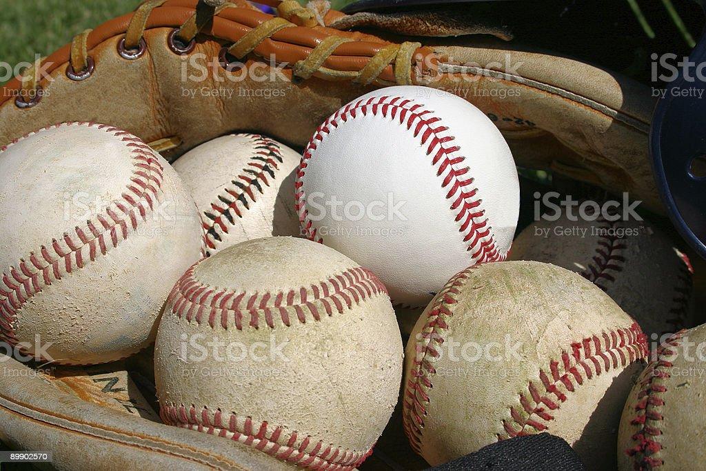 Glove full of baseballs