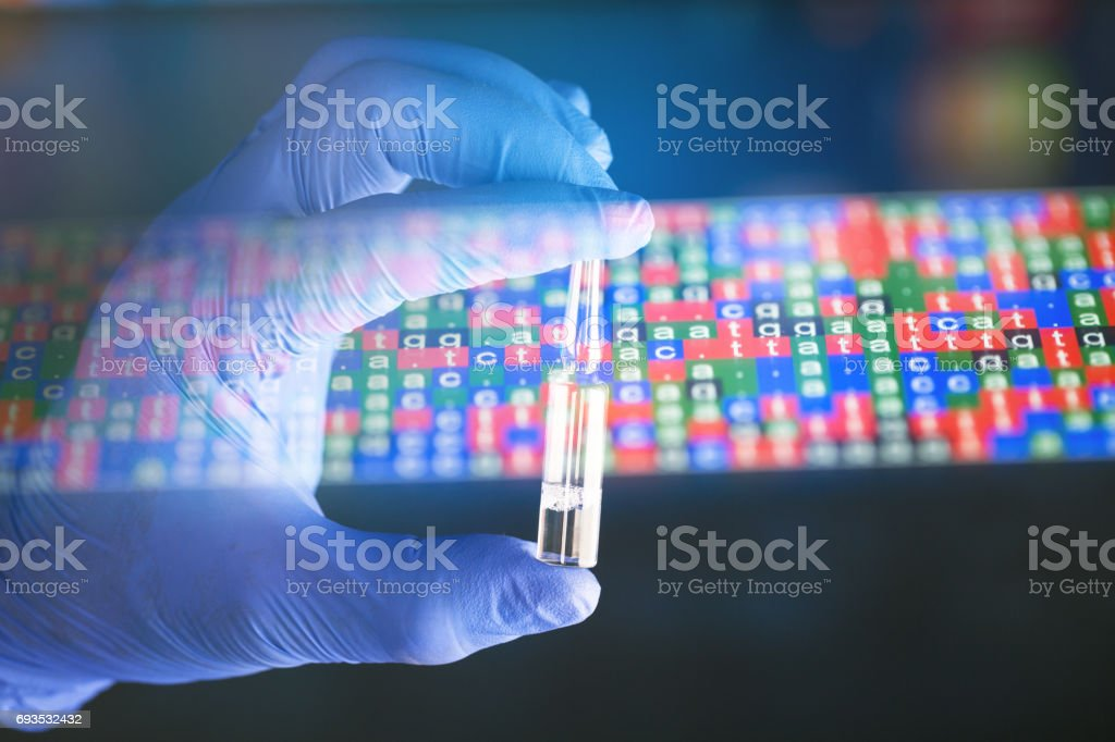 glove hand hold vaccine with illumianted DNA code stock photo