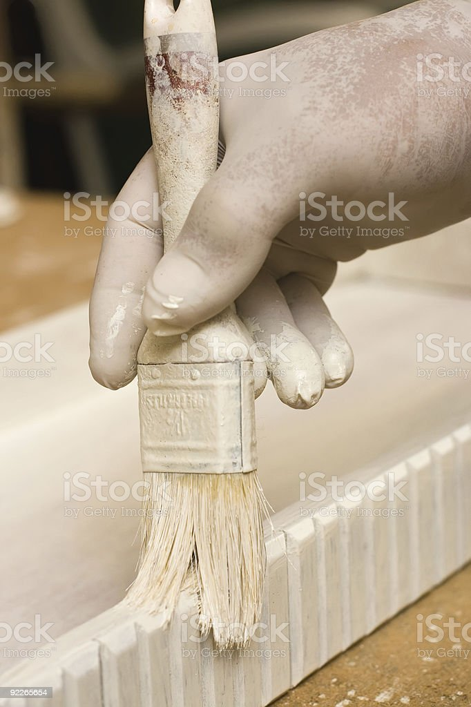 Gloved carpenter's hand royalty-free stock photo
