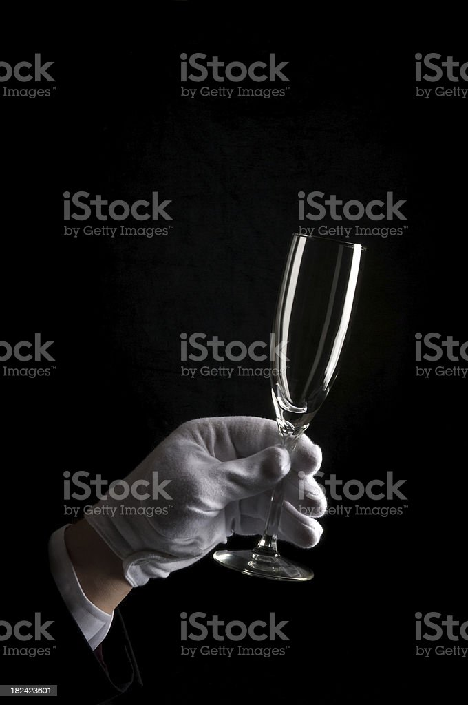 Gloved Hand holding Champagne Glass royalty-free stock photo