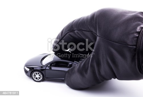 istock Gloved Hand is holding a car 464781911