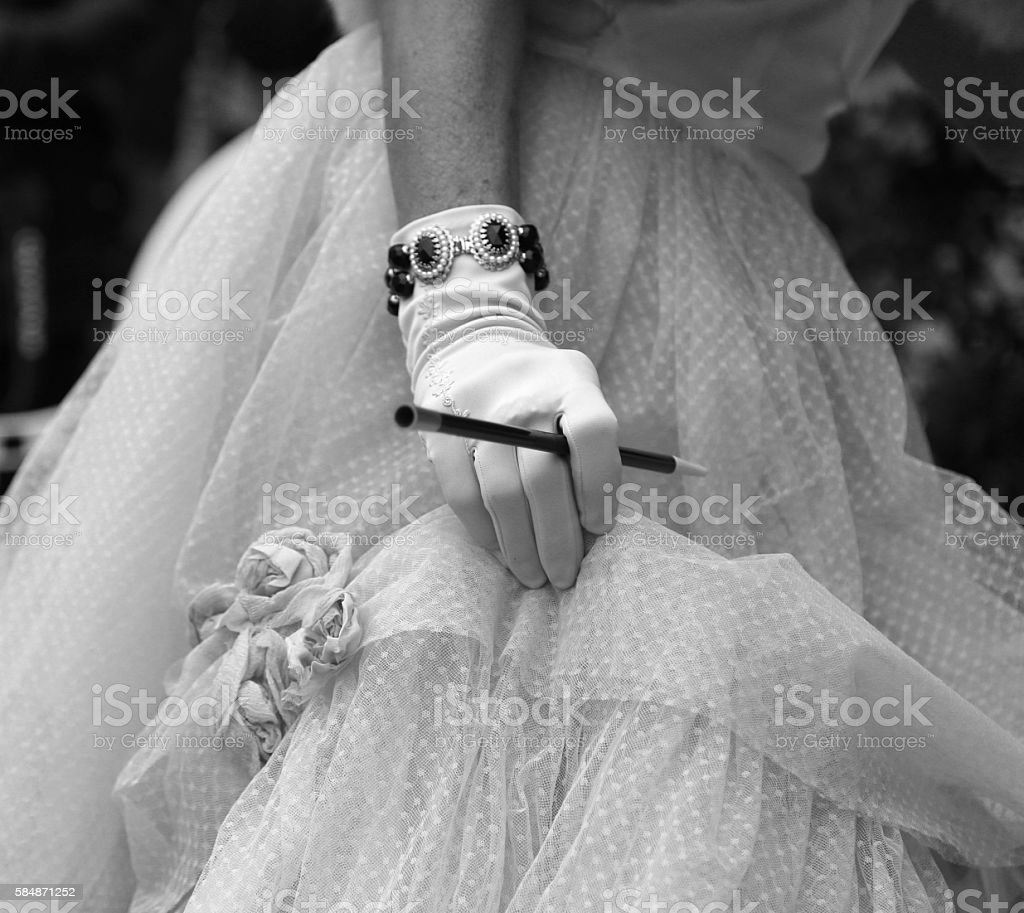 gloved hand on the elegant lady with the cigarette holder stock photo